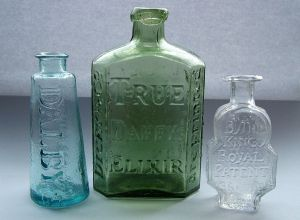 1024px-Three_early_medicine_bottles